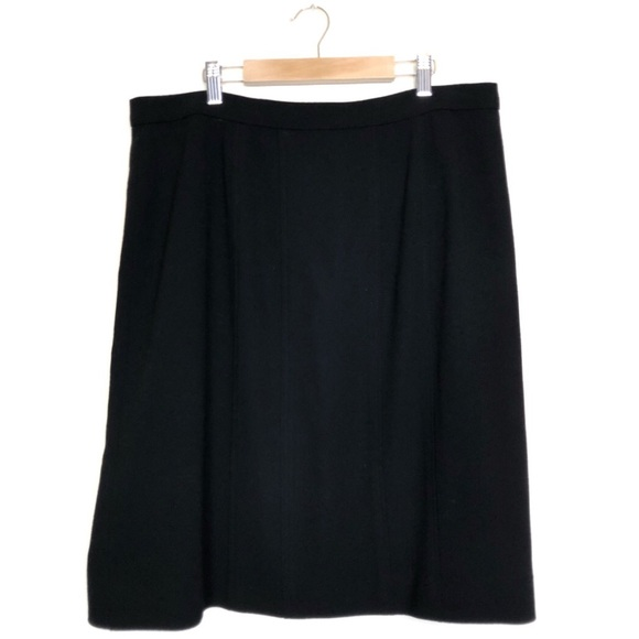 CHANEL Dresses & Skirts - Chanel Black Wool Skirt Silk Lining Logo Button